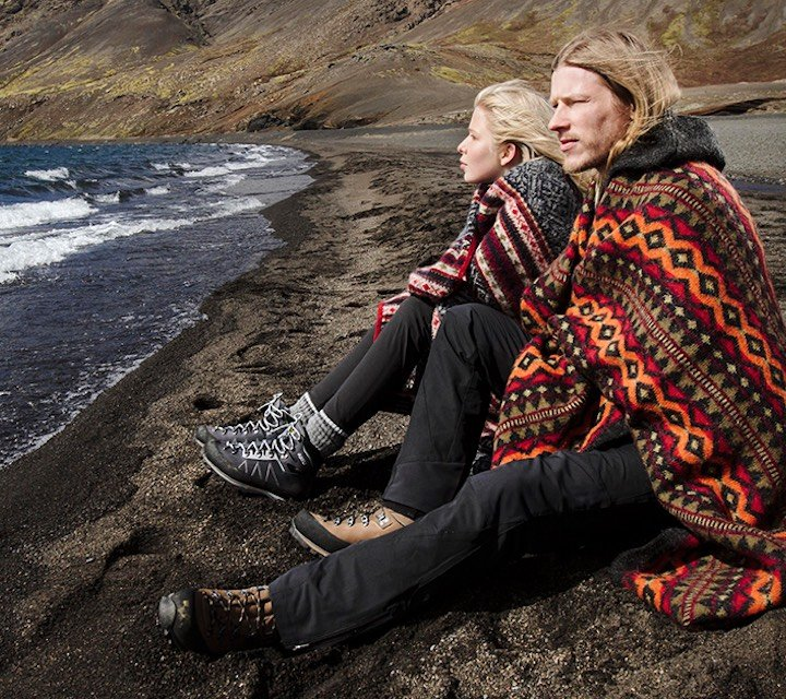 man and women on beach with Icelandic wool blankets