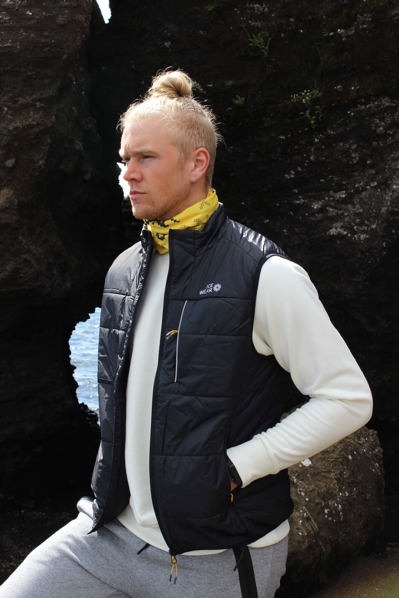 man iceland outdoor rocks with vest